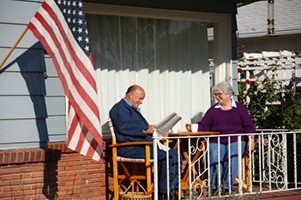 Utah reverse Mortgage couple reading on their porch