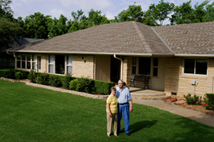 reverse mortgage couple in front of house